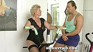 Horny granny slut shamelessly takes gym traine...