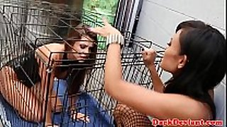 Caged lesbian pet toyed with machine sex tool