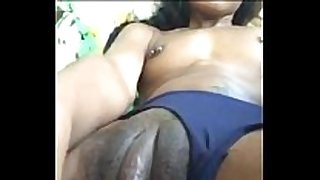 Ebony honey with big love button strokes her fur pie