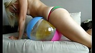 Sophie masturbating her love tunnel with her green bi...