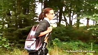 Busty schoolgirl is drilled in the woods