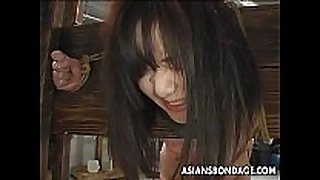 Asian floozy has a waxing and drubbing bdsm session