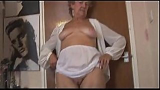 Blonde granny in nylons posing and teasing