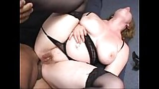 Chubby redhead screwed in the arse wearing a strap
