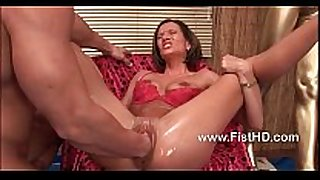 Horny bitch maia takes a large fist up her fur pie