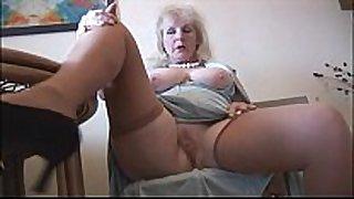 Curvy older black cock slut in nylons disrobes and positions