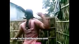 Indian black cock sluts from village taking open air shower...