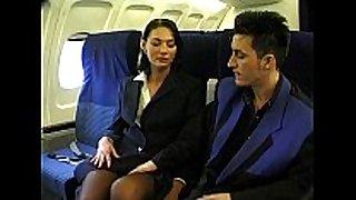Brunette beauty wearing stewardess uniform receives...