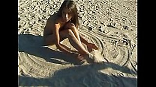 Beautiful recent faced legal age teenager plays at the beach bare