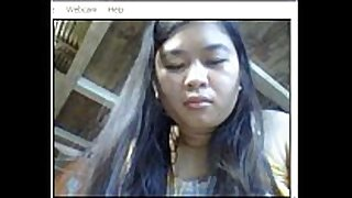 Asian showing on webcam- risa