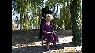 Granny receives a lesson from masked dude