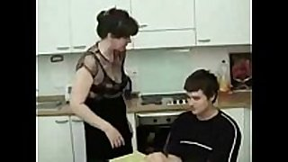 Hot mama and son in the kitchen