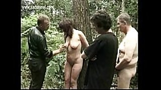 Milf serf fastened to a tree receives spanked on her l...