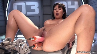 Asian hoe takes one huge dildo in her pussy and one in the ass