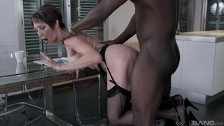 Short-haired mature in black stockings gets boned on the table